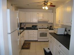 White Kitchen Cabinets With Black Island by Kitchen Lowes Kitchen Islands For Provide Dining And Serving