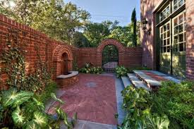 backyard with brick fences and metal gate outdoor brick fences