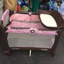 graco pack and play with changing table pink and brown graco pack n play with changing table table designs