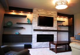 floating shelves on stone wall