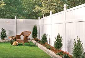 Fencing Ideas For Backyards by White Vinyl Fence With A Small Raised Border Very Cute And Clean