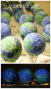 earth globes that light up paper mache light up globes housing a forest