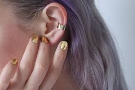 gold ear cuff ear cuff mine had a lil heart hanging from it memories
