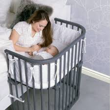 babybay bedside sleeper is the baby crib that attaches to your bed
