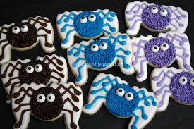 the royal icing queen spider cookies tutorial with pictures