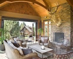 3 season porch rustic with gray birdhouses wicker