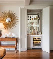 furniture oversize sunburst mirrors and glass shelves also sub