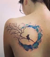 black cat sitting on branch in watercolor moon on shoulder