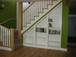 understairs shelving make one section hinged as a door to reach