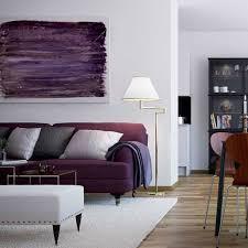 modern living room with swing arm floor lamp and purple sofa