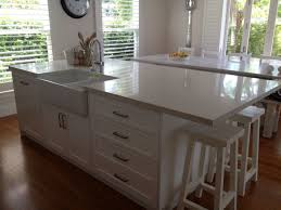 kitchen island with sink and dishwasher and seating square white