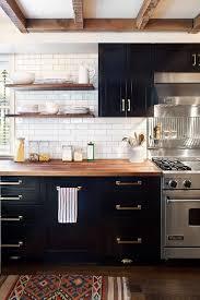 black kitchen cabinets with white subway tile backsplash kitchen with floating shelves cabinets and