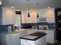 tiles backsplash dark countertops with white cabinets cabinet