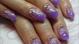 purple acrylic nails with a glitter overlay using cjp u0026 naio