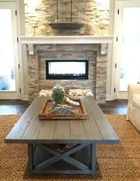 stacked stone double sided fireplace flanked by french doors
