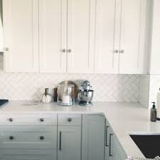 How To DIY A White Herringbone Kitchen Backsplash We Are So - Backsplash white