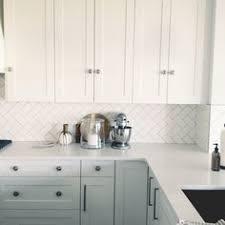How To DIY A White Herringbone Kitchen Backsplash We Are So - Herringbone tile backsplash