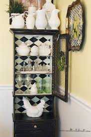 domino effect re arranging my black china cabinet a cultivated nest