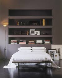 modern gray and white bedroom with leather coated bed also white