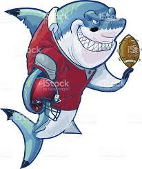 mean cartoon football shark with helmet and ball stock vector art