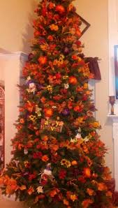 tree decorated for fall in the family room