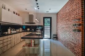rustic look red brick wall the highlight of the kitchen design