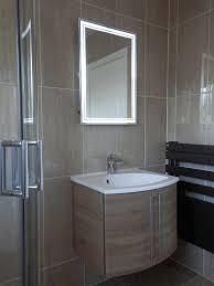backlit mirrors for bathrooms dark brown wooden sink cabinet