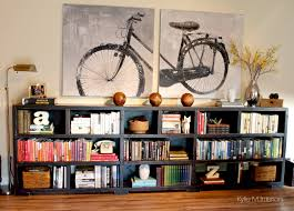 ideas to personalize a home with home decor and books on a long ideas to personalize a home with home decor and books on a long low bookcase arrange books by colour oversized bike canvas artwork
