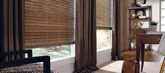 horizontal window blinds between glasses