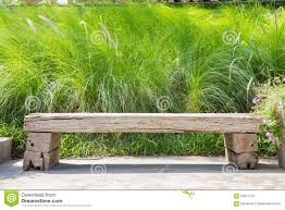 wooden bench on green grass background stock photo image 64817175