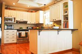 wood countertops kitchen cabinets painted white lighting flooring