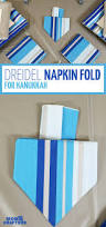 Hanukkah Decorations Ideas Try This Easy Dreidel Napkin Fold Hanukkah Napkins And Decoration
