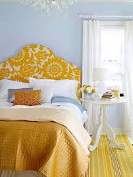guest bedroom decor with yellow blanket and headboard and white