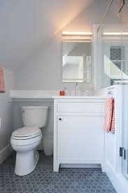 Small Attic Bathroom Sloped Ceiling by Attic Bathroom With Sloped Ceiling Over Tiny Washstand