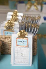 baby shower bingo and raffle on mini gold clipboards for each