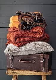 Earthy Orange Channel Ski Lodge Chic With Chunky Knit Cushions And Throws Burnt