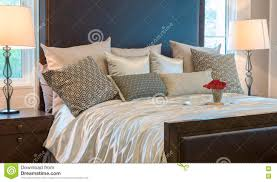 Luxury Bedroom With Brown Pattern Pillows And Decorative Tray