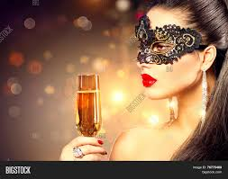 halloween masquerade background model woman with glass of champagne wearing venetian