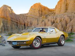 69 l88 corvette 1969 chevrolet corvette l88 gold 3 4 front view on pavement by