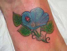 glory tattoo jakarta hummingbird and flower tattoos glory floral tattoo leg morning