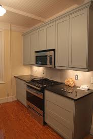 simple white kitchen cabinet with granite countertops kitchen