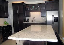 interior design new caledonia granite countertop white cabinets