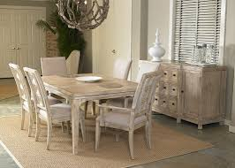 brushed white oak dining table with nail heads in medium oak finish