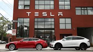 tesla plans to produce 20 000 model 3 a month by december the drive