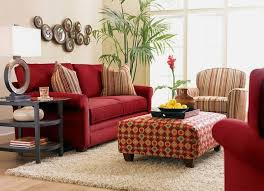 red sofa design and brown stone wall design with farmes in modern