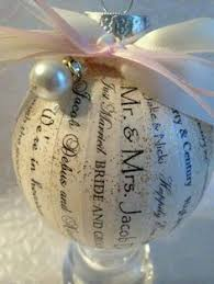 use wedding invitation to make a tree ornament for the newlyweds