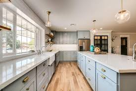 blue shaker cabinets with gold hardware transitional kitchen