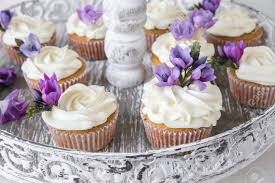 vintage cake stand cupcakes with purple edible flowers on vintage cake stand for