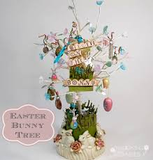 easter ornament tree easter bunny tree with ribbon flowers plucking daisies