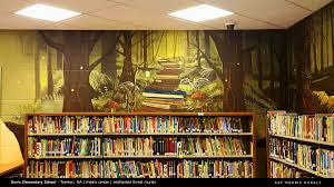 media center murals davis elementary school on behance closeup of the book trail mural the image found by the media center director wasn t large enough to cover the space which is where my photoshop skills